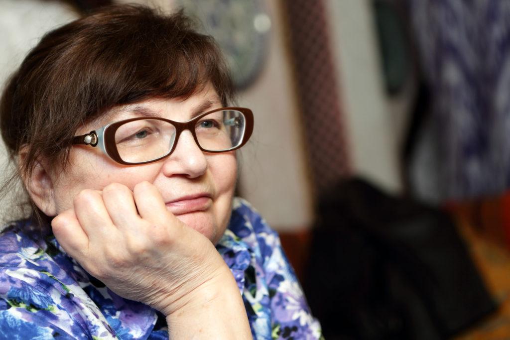 Portrait of a pensive senior woman in glasses